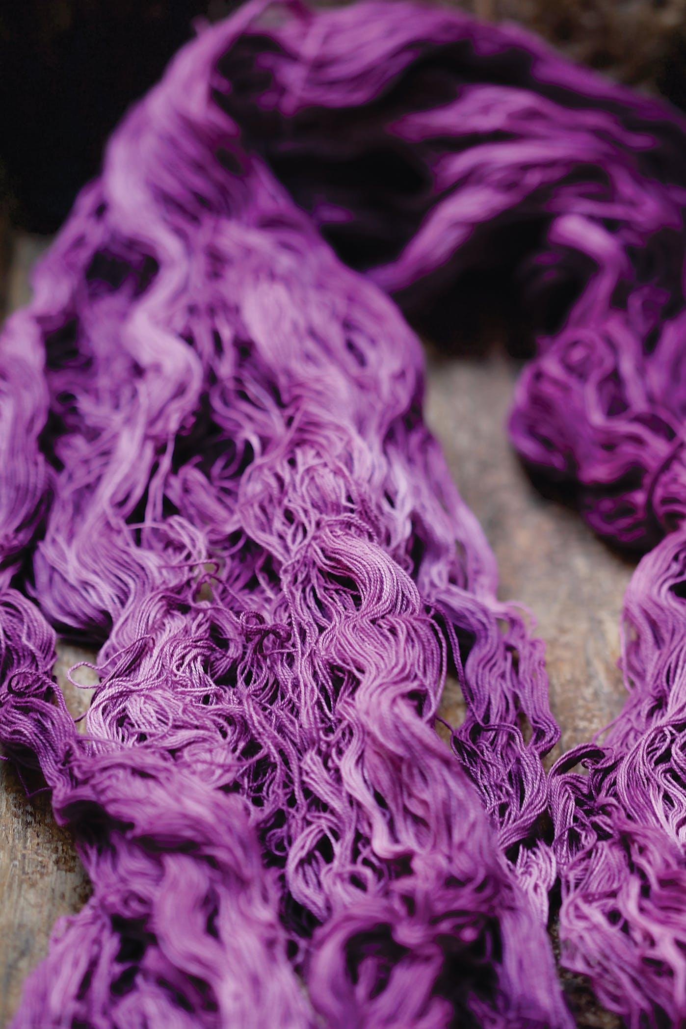 Purple yarn made by a Mixtec dyer using tixinda