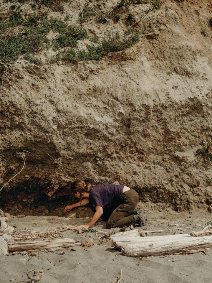 Heidi Gustafson foraging for ochre in a sandy hillside
