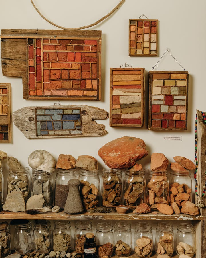 Ochre wall art and jars filled with ochre samples