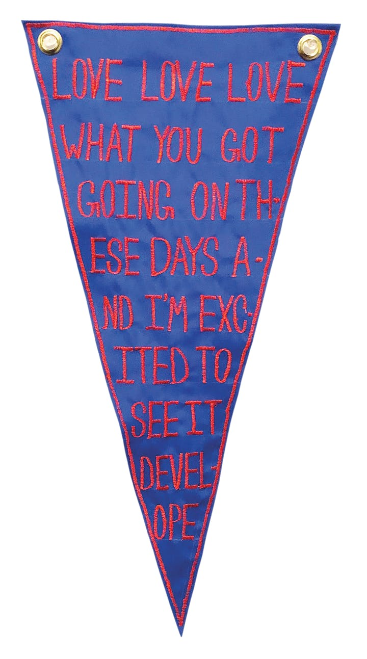 Blue nylon flag with red lettering