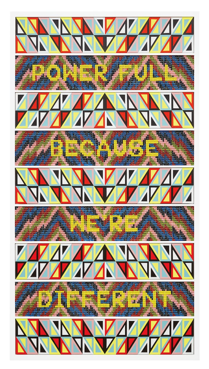 Multicolored tapestry with the words Power Full Because Were Different