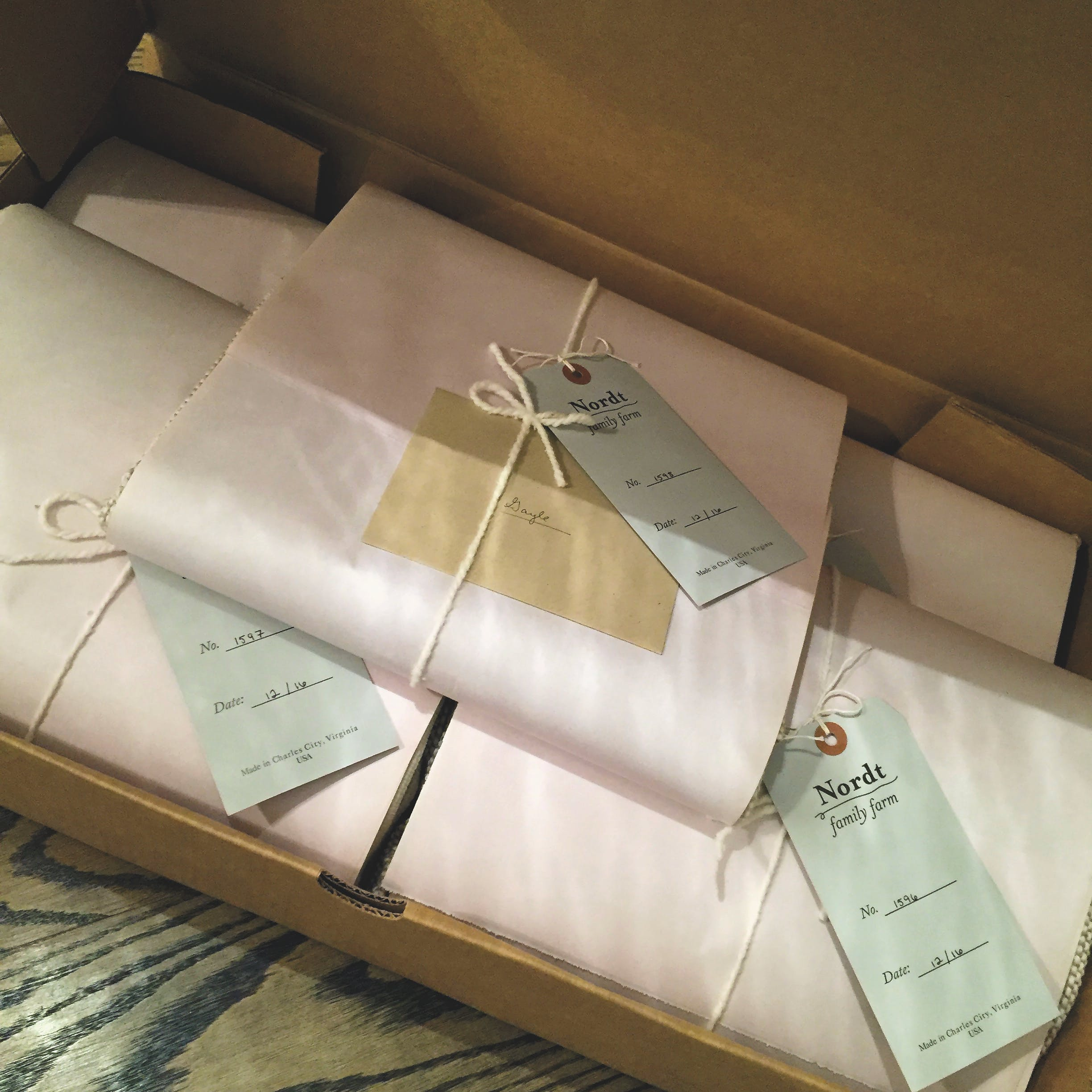 package of blankets wrapped in tissue paper with handwritten notes