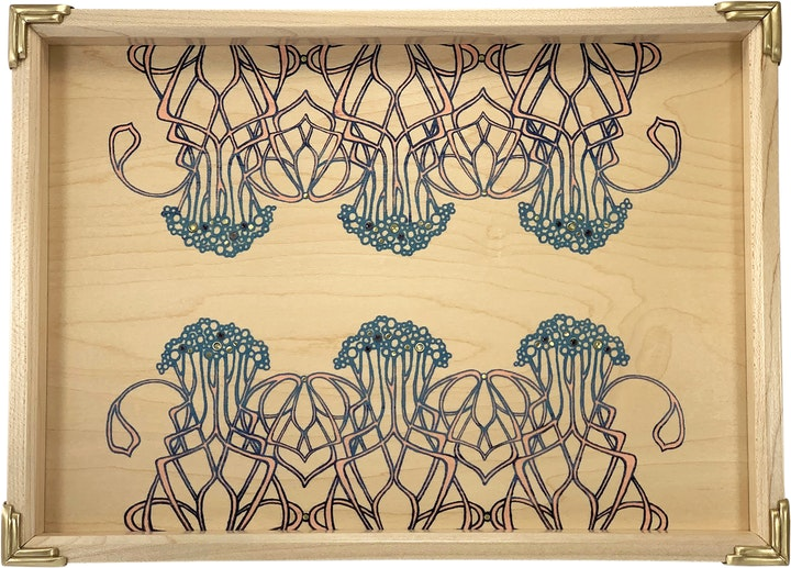 Rectangular tray in light maple with intricate printed art nouveau pattern and brass corners