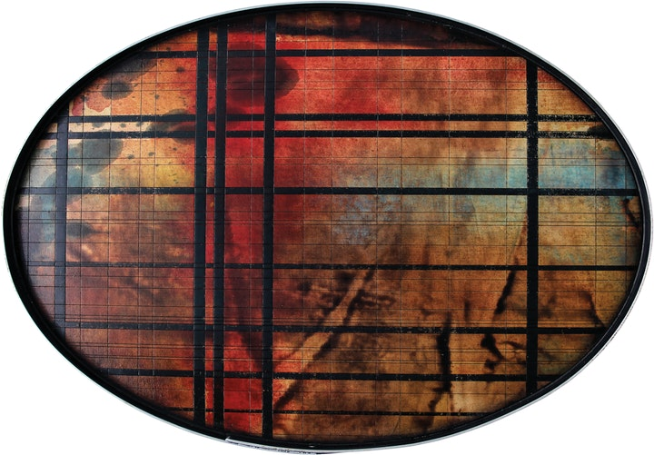Oval wood tray with grid pattern over deep blotchy coloration