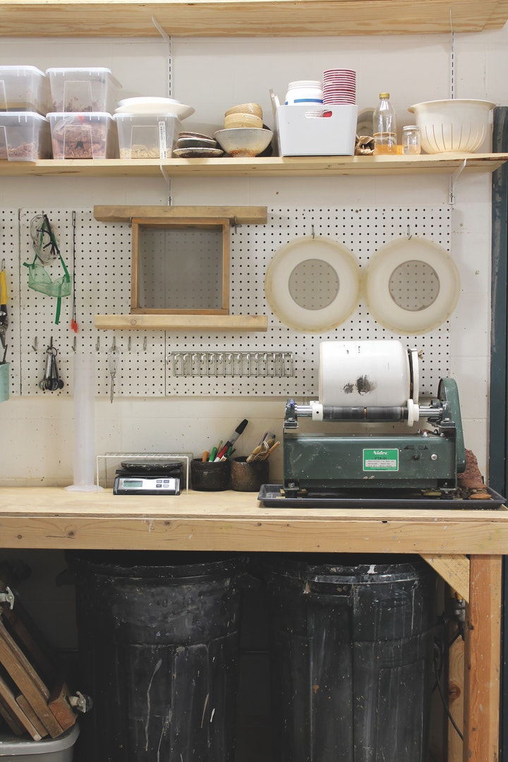 Studio work bench with various equipment and supplies