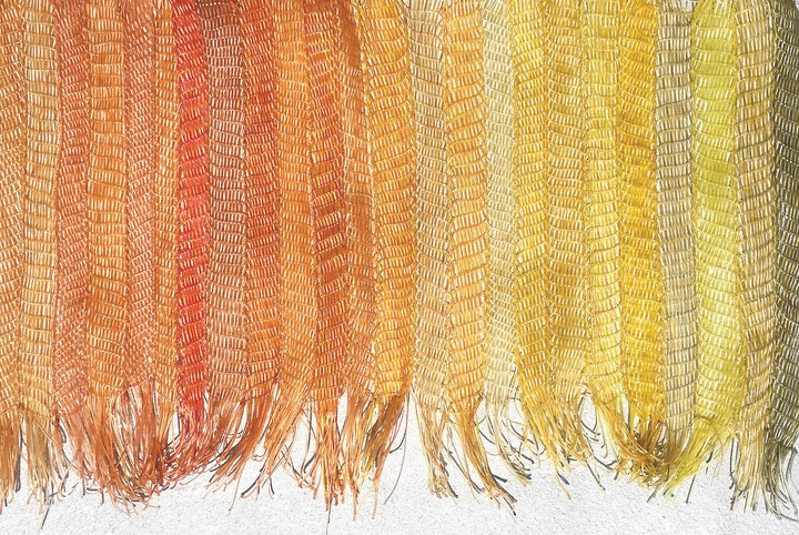 Warm-colored mat braided from strands of agar