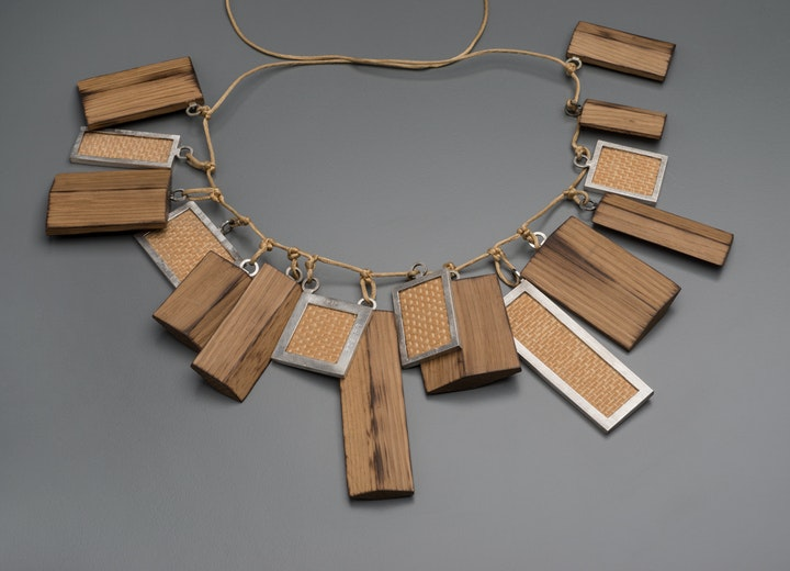 Necklace with various wood ornaments