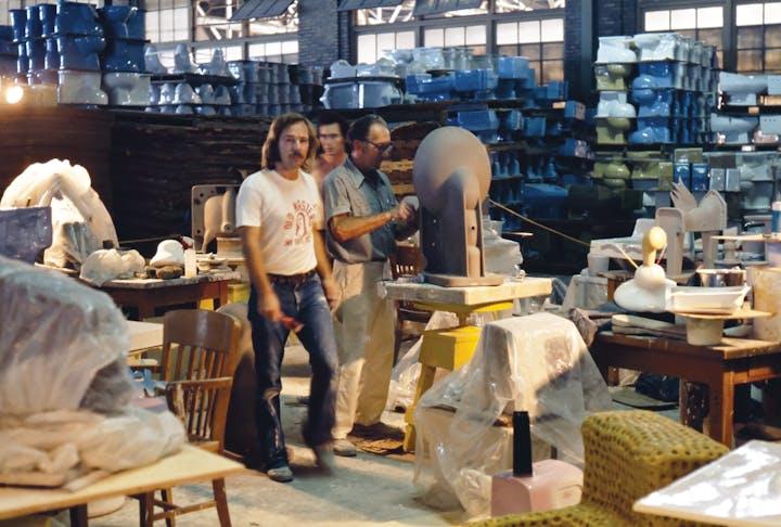 1974 photo of three people working in an industrial arts studio