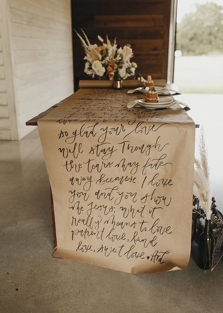 Calligraphied brown paper table covering draped over a table