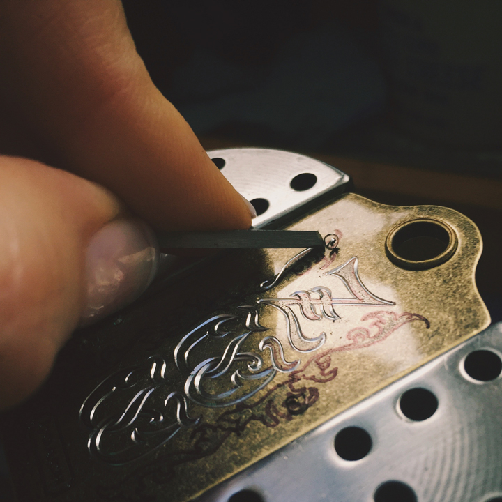 Close-up of a peice of metal being engraved