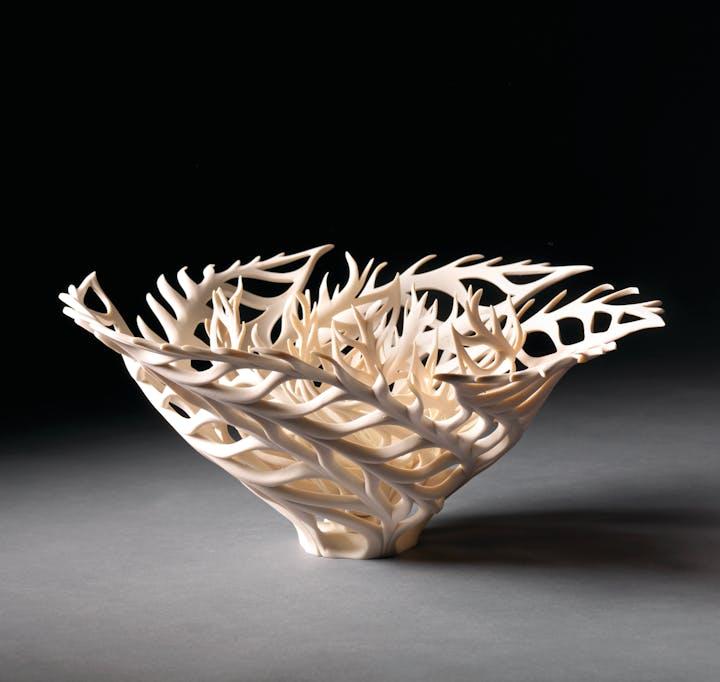 Delicate porcelain bowl reminiscent of a coral skeleton