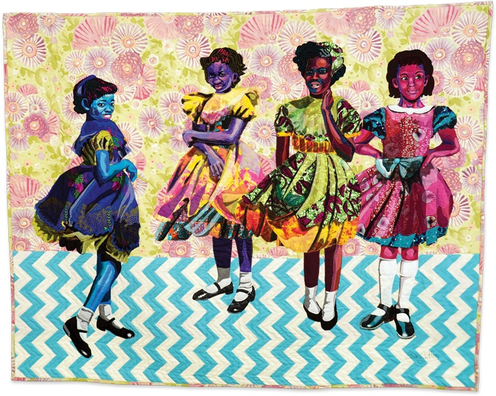 portrait of four young girls in dresses in the form of a colorful and richly patterned quilt