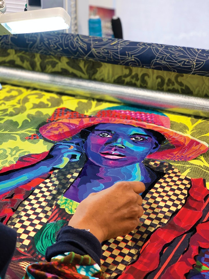 process shot of a colorful quilted portrait of a woman being made