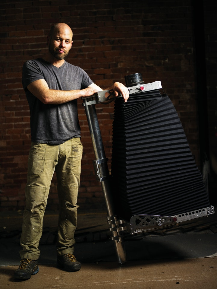 photographer posing with a large self built ambrotype camera