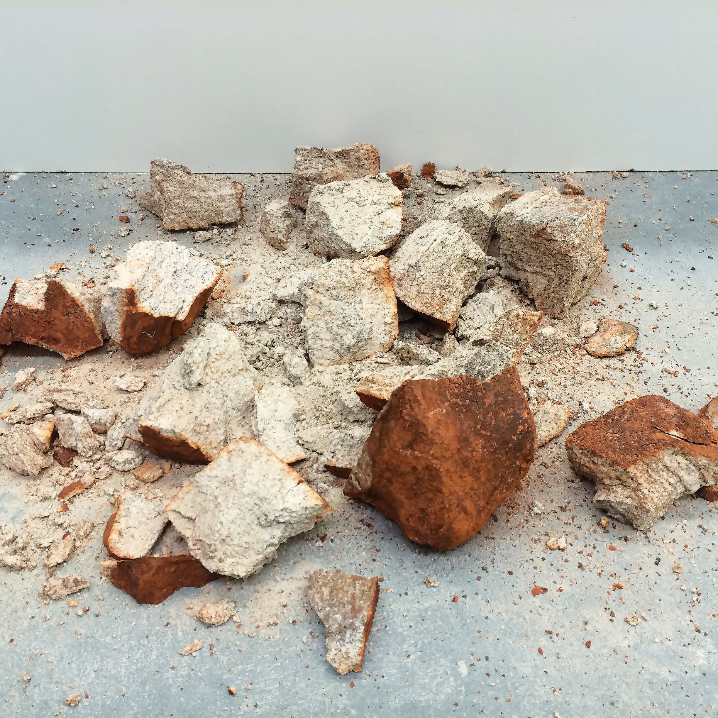 a large stone smashed into crumbly sandy pieces