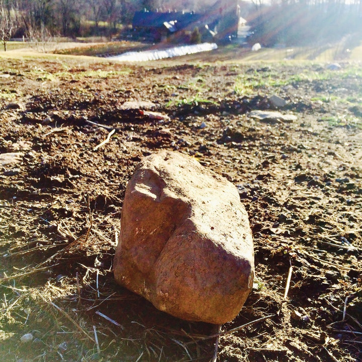 large stone by itself in a field