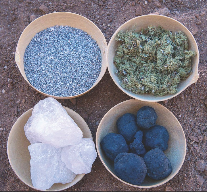 four bowls with various materials for dyeing wool