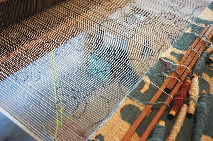 weaving in progress on a traditional loom