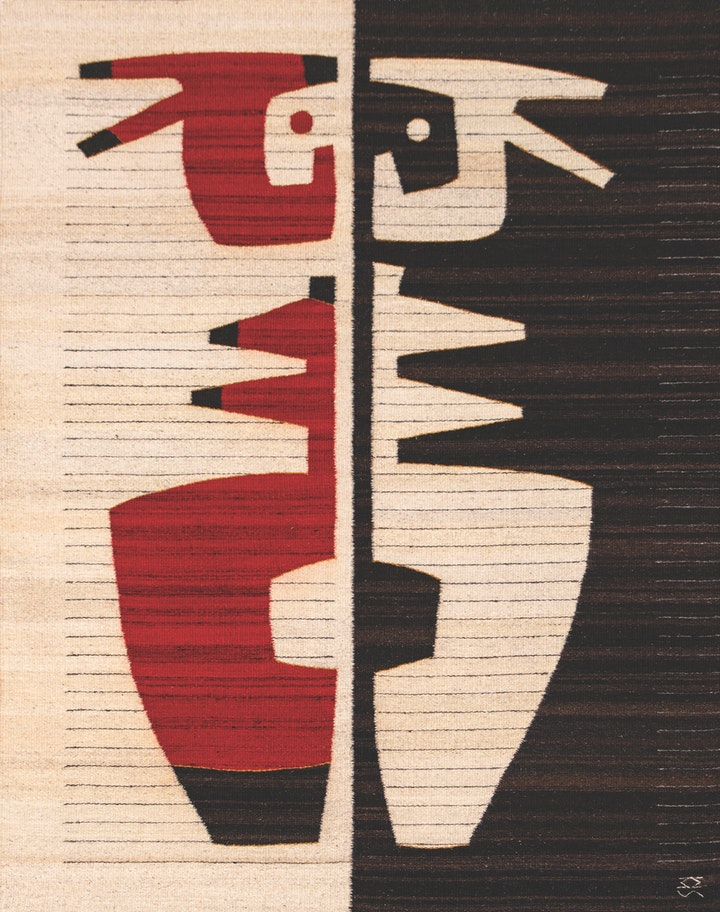 black white and cream weaving a symmetrical symbol