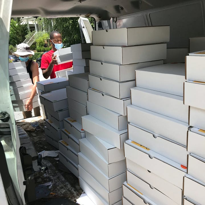 Take Home Craft Atlanta boxes being loaded into a van