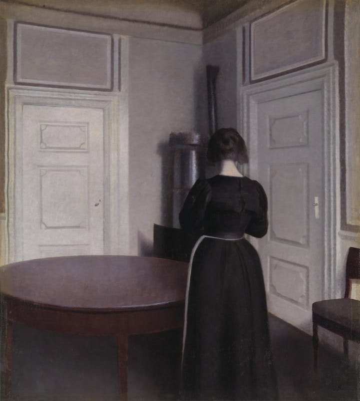 painting of back of woman standing in a room beside a round table