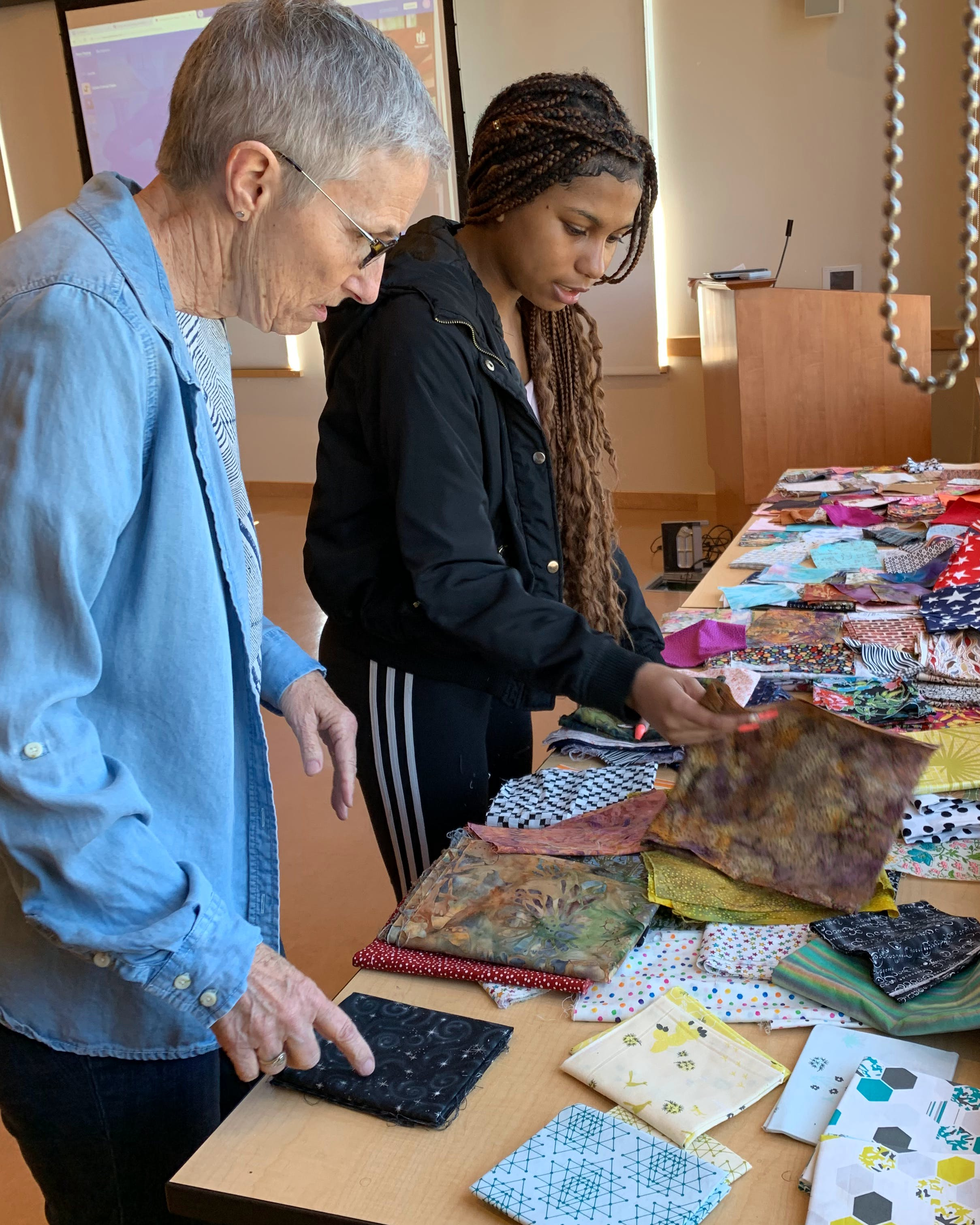 Two people picking out fabric samples