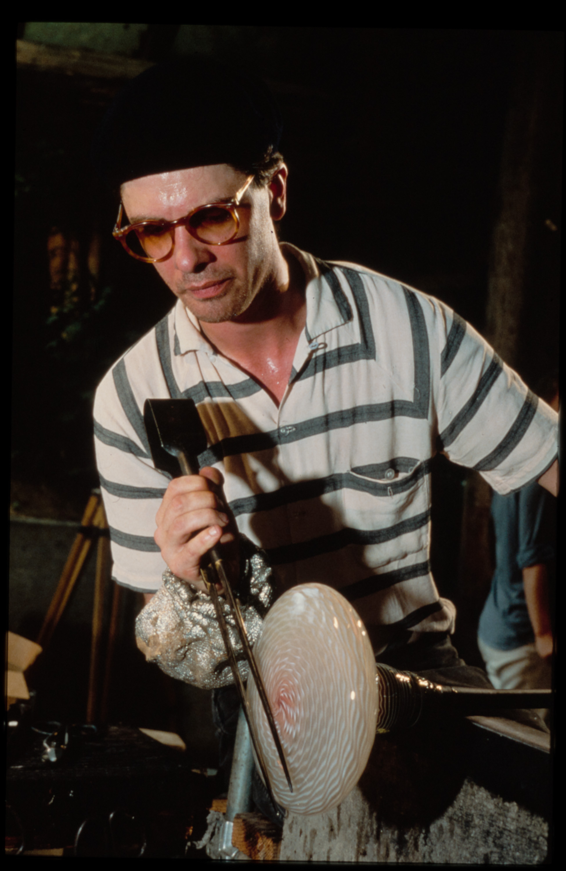 Artist at work on a blown glass object