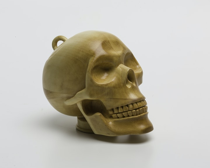 Wooden teapot fashioned after a skull