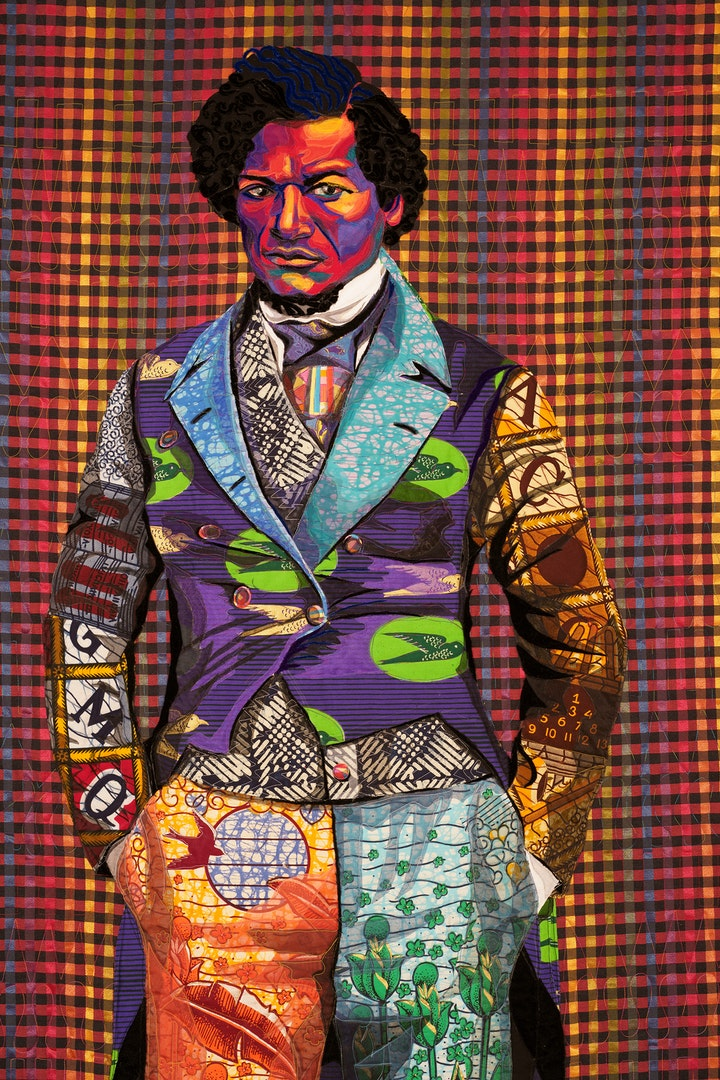 detail of a quilt depicting a young frederick douglas staring at the viewer wearing vibrant patterned clothing