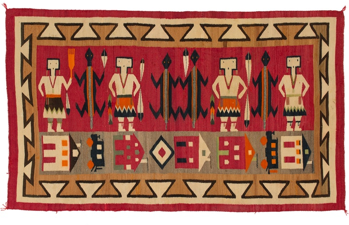 red orange tan and black navajo pictoral textile with people animals houses and train cars