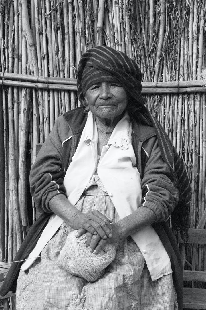 black and white portrait of an oaxacan wool spinner