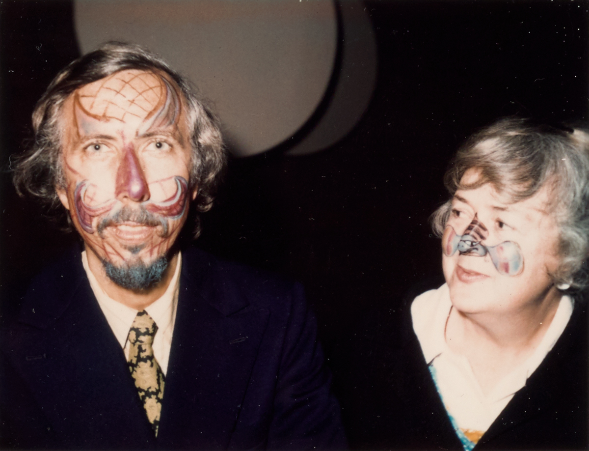 A man and woman wearing face paint