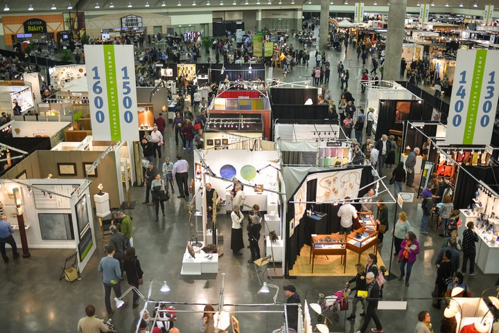 Overhead shot of busy craft show floor with rows of artist booths