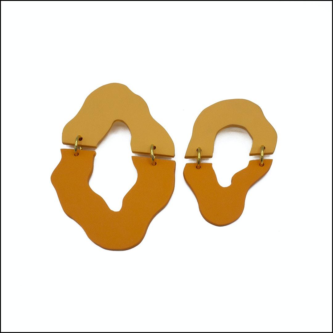 pair of orange earrings