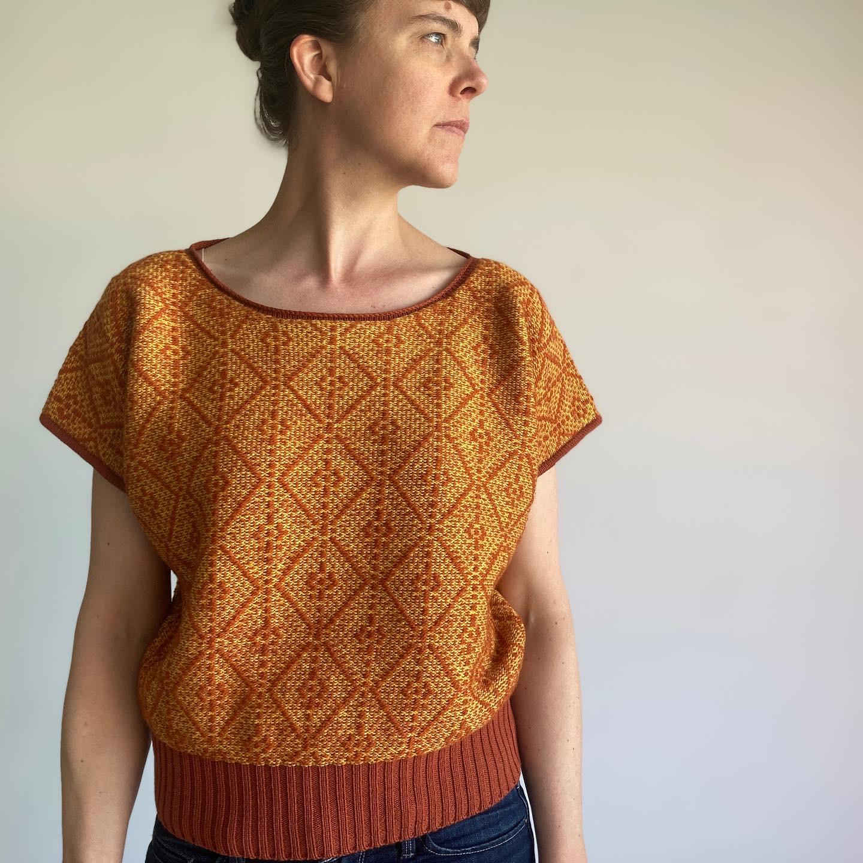 model wearing knit orange shirt